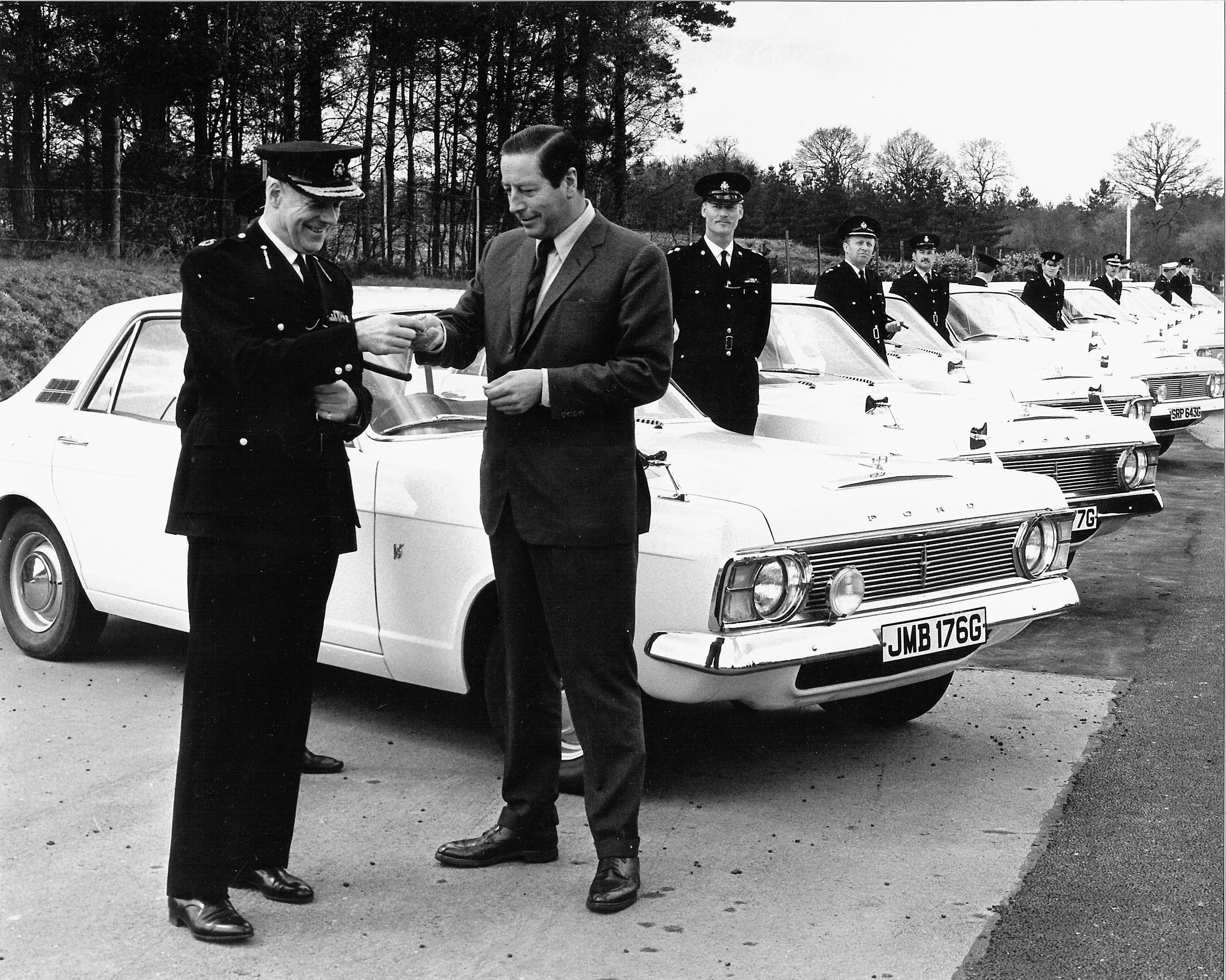 Tony Rolt presenting keys of 4WD Ford Zephyr police cars